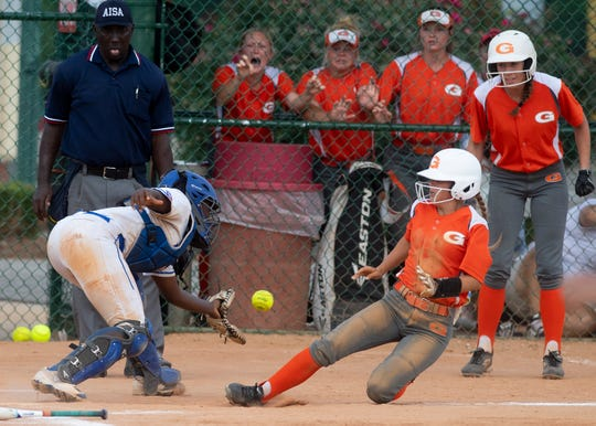 Glenwood's Chloe Enfinger scores the winning run on an error as Macon East's Devyn Debardelaben takes the throw in the AISA State Softball Championship game at Lagoon Park in Montgomery, Ala., on Friday May 3, 2019.