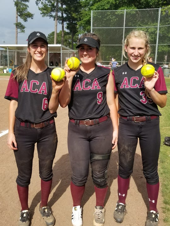 From left, Alabama Christian's Haley Pittman, Monica Willingham and Haley Ingram show off their home run balls on Wednesday.