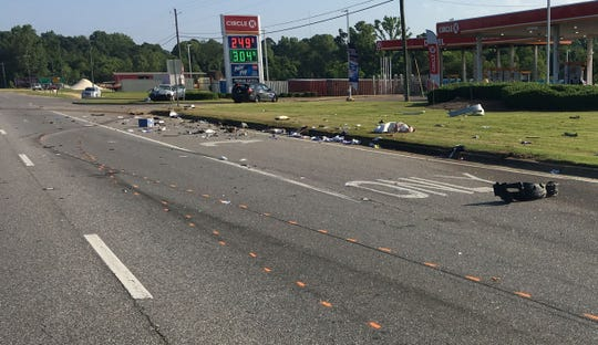 Debris from the crash is scattered across the roadway.