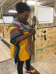 Michelle Browder of More Than Tours prepares to throw an axe at Civil Axe Throwing in downtown Montgomery.