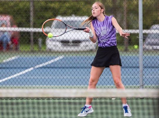 Delta's Maggie Hunt plays a singles match Thursday during SmashCancer 8.0 at Yorktown High School.