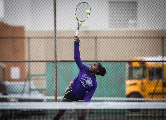 Delta and Yorktown tennis players square off during Smash Cancer 2019 at Yorktown High School Thursday evening. The event, which raised funds for cancer research, started with a ceremony honoring local survivors.