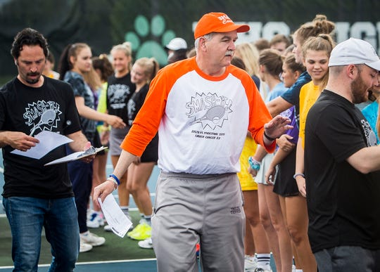 FILE -- Delta tennis coach Tim Cleland makes his rounds during the 2019 edition of Smash Cancer at Yorktown High School. The event, which raised funds for cancer research, started with a ceremony honoring local survivors.