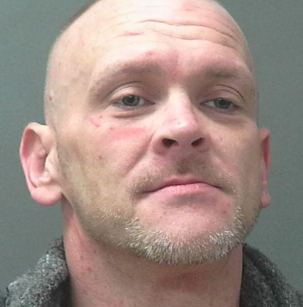 Man held for burglary, sexual battery after manhunt
