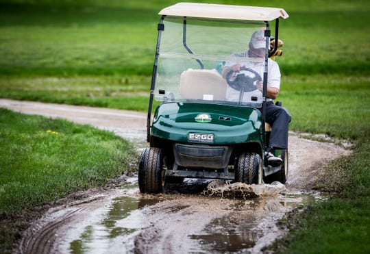A few golfers worked on their game at Crestview Golf Club Friday. A rainy, cloudy April has dampened golf activity at local courses.