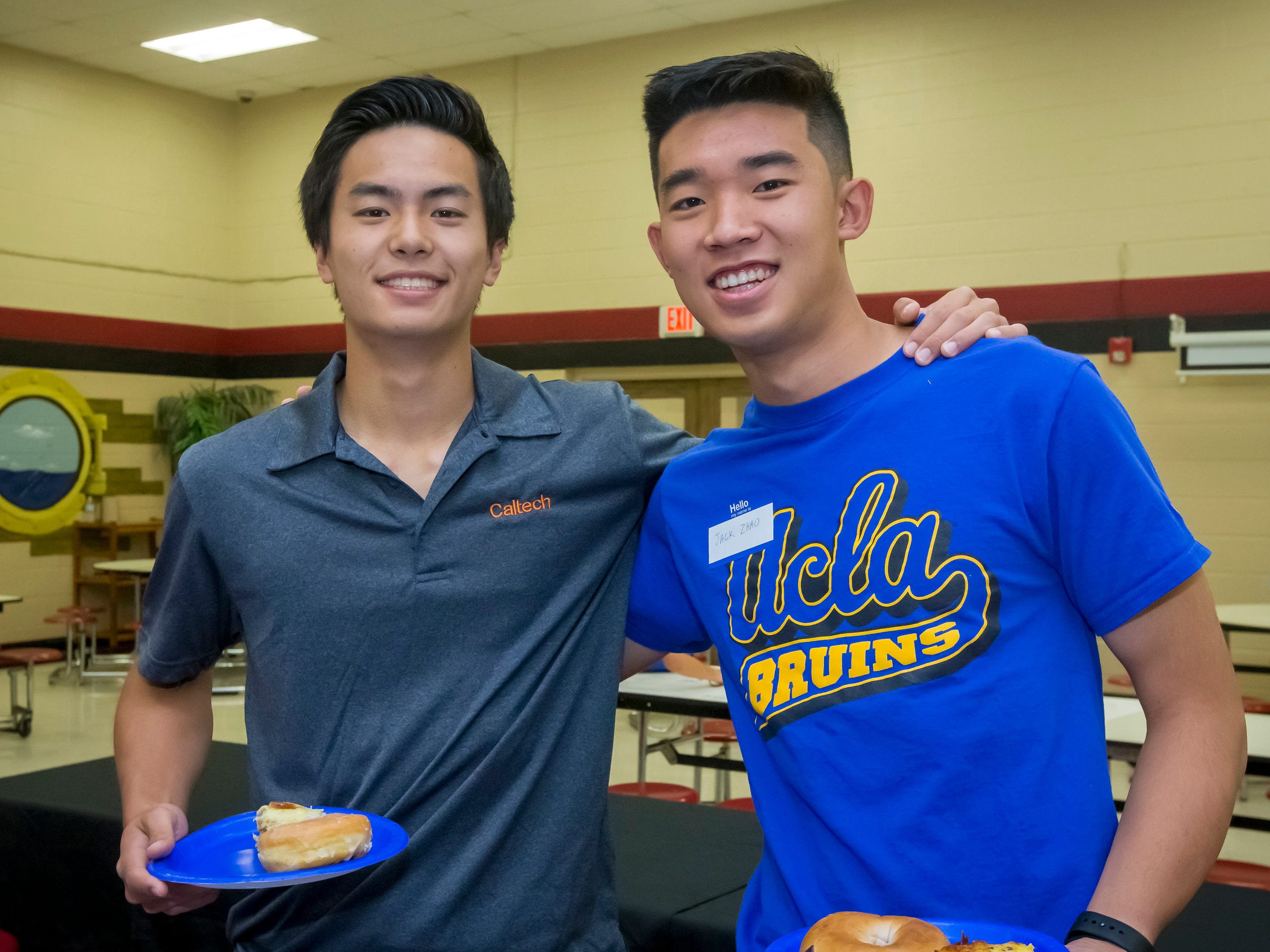 Jack Zhao and Nathan Zoe joined other former students at Discovery School at Bellwood in the Senior Walk Friday, May 3, 2019.