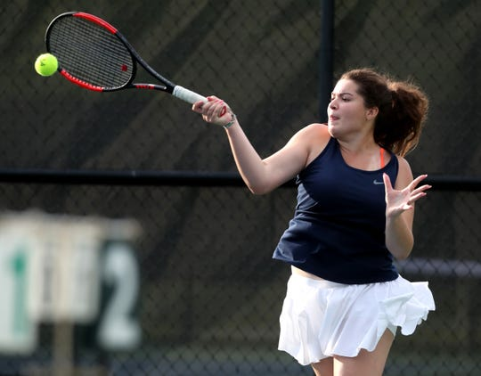 Anna Mincey, of Blackman hits the ball during the girls singles round of the District 7 Large Individual Tennis Tournament on Thursday, May 2, 2019, at Old Fort Park, in Murfreesboro.