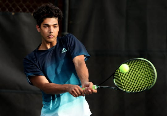 Hussain Alzubaidi of Siegel hits the ball during the boys doubles round of the District 7 Large Individual Tennis Tournament on Thursday, May 2, 2019, at Old Fort Park, in Murfreesboro.