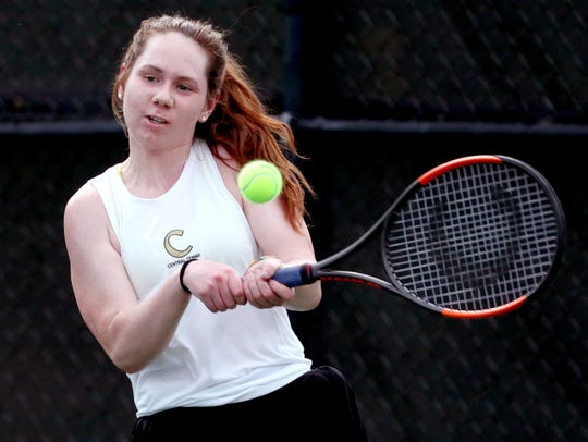 Mamie Sevier, of Central Magnet hits the ball during the girls singles round of the District 7 Large Individual Tennis Tournament on Thursday, May 2, 2019, at Old Fort Park, in Murfreesboro.