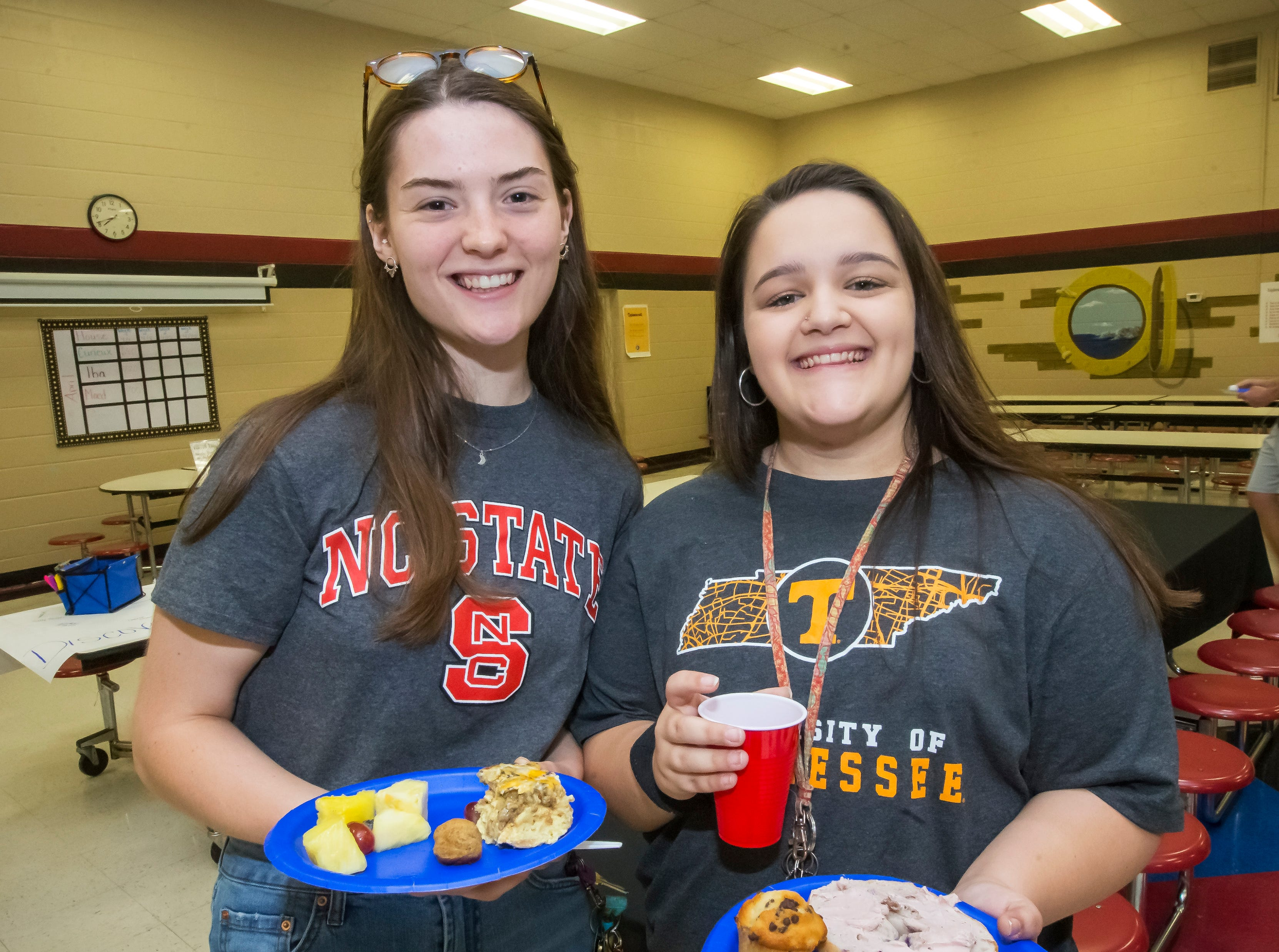Zoe Chavis and Abby Cornelison joined other former students at Discovery School at Bellwood in the Senior Walk Friday, May 3, 2019.