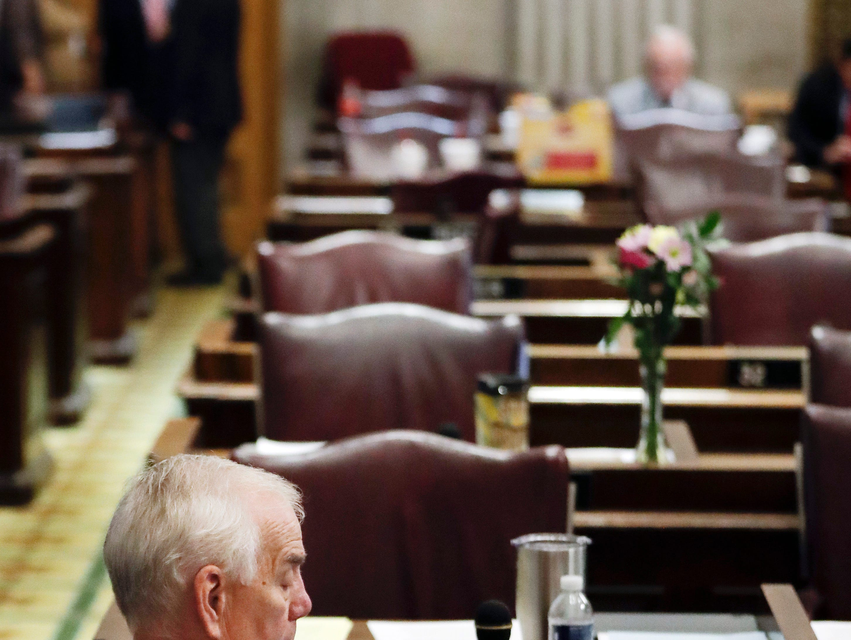 Rep. Pat Marsh, R-Shelbyville, checks his phone as he waits for the House session to resume Thursday, May 2, 2019, in Nashville, Tenn. (AP Photo/Mark Humphrey)