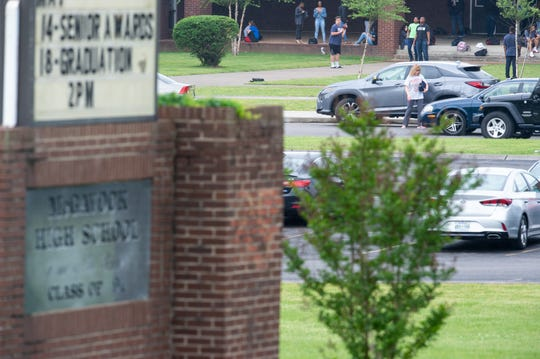 Parents pick up students outside McGavock High School where over 120 teachers are absent during a budget protest Friday, May 3, 2019, in Nashville, Tenn.