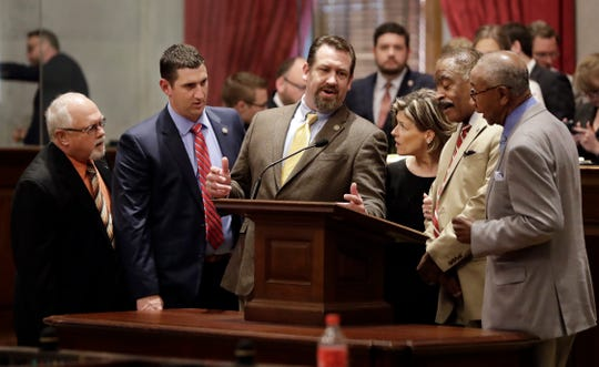 Members of the House of Representatives sing hymns during a break as they wait for the session to start back up Thursday, May 2, 2019, in Nashville, Tenn. From left are Sergeant-at-arms Wayne Hawkins; Rep. Clay Doggett, R-Pulaski; Rep. Jeremy Faison, R-Cosby; Rep. Terri Lynn Weaver, R-Lancaster; Rep. John DeBerry, D-Memphis; and Rep. Johnny Shaw, D-Bolivar. (AP Photo/Mark Humphrey)