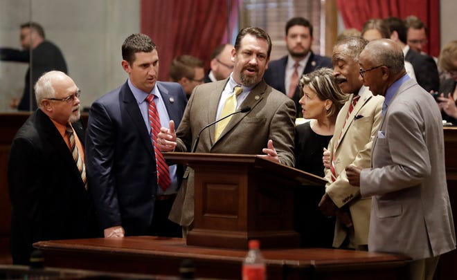 Members of the House of Representatives sing hymns during a break as they wait for the session to start back up on May 2 in Nashville. From left are Sergeant-at-arms Wayne Hawkins; Rep. Clay Doggett, R-Pulaski; Rep. Jeremy Faison, R-Cosby; Rep. Terri Lynn Weaver, R-Lancaster; Rep. John DeBerry, D-Memphis; and Rep. Johnny Shaw, D-Bolivar.