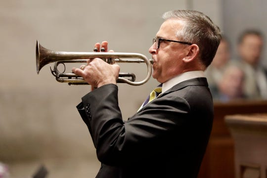 Rep. Bill Sanderson, R-Kenton, plays the cornet during a break as the House of Representatives waits for the session to start back up Thursday, May 2, 2019, in Nashville, Tenn. (AP Photo/Mark Humphrey)