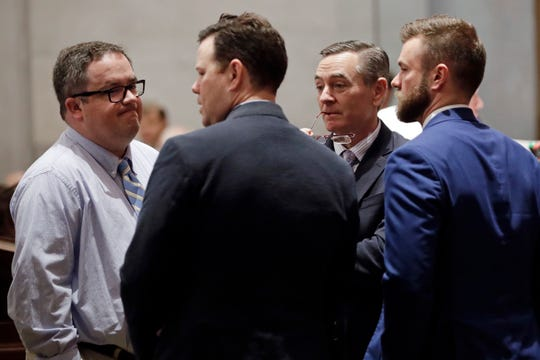 House Speaker Glen Casada, R-Franklin, second from right, talks with Rep. Matthew Hill, R-Jonesborough, left; Rep. Michael Curcio, R-Dickson, second from left; and Cade Cothren, chief of staff for Speaker Casada, right; during a Senate session Thursday, May 2, 2019, in Nashville, Tenn. (AP Photo/Mark Humphrey)