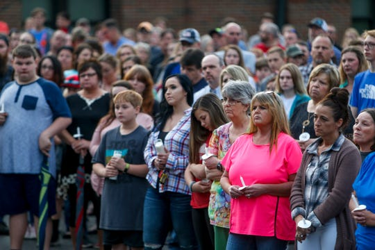 Community members gather in front of the Westmoreland Middle School at a vigil on Thursday, May 2, 2019 in Westmoreland, Tenn. The vigil was held for the seven victims of a slaying over the weekend in Sumner County.