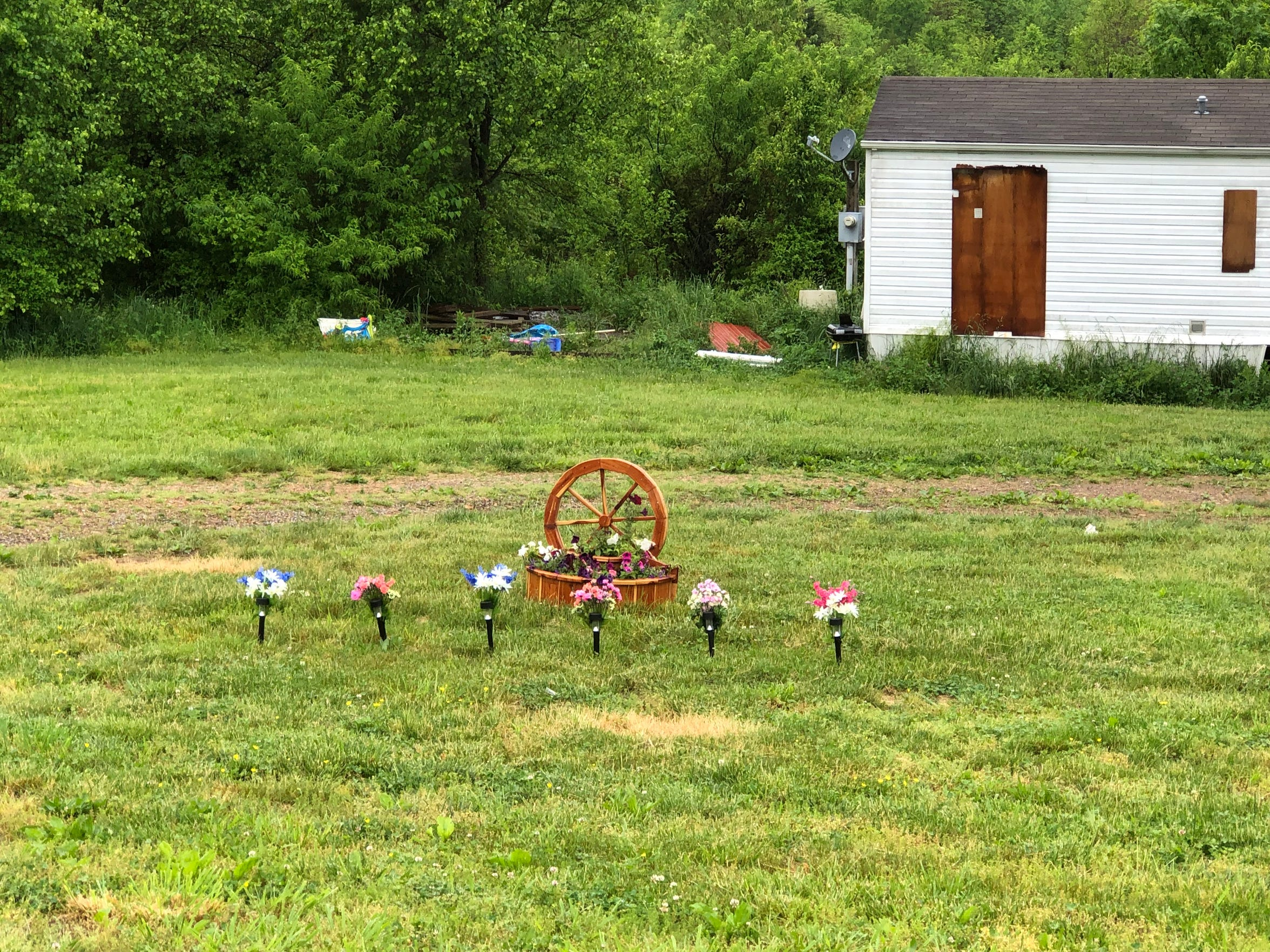 A memorial has been placed outside the Cummins home.
