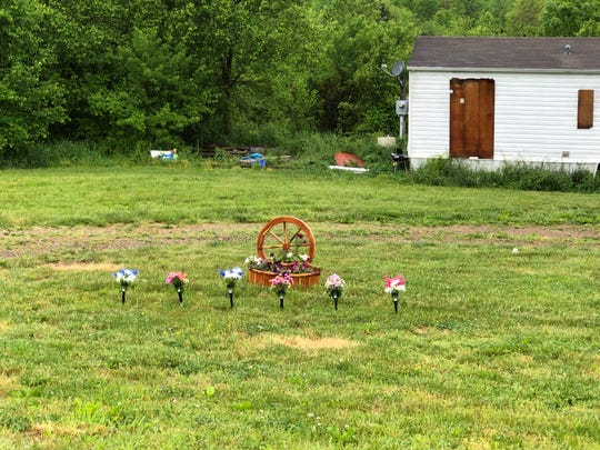 A memorial has been placed outside the Cummins' home.