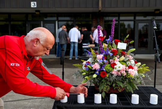 City councilman David Leath lights candles for each of the victims honored at a vigil held at Westmoreland Middle School in Westmoreland, Tenn., on Thursday, May 2, 2019. The vigil was held for the seven victims of a slaying over the weekend in Sumner County.