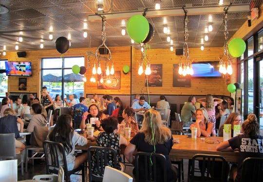 The North Naples location of BurgerFi was bustling Thursday night, May 2, 2019, for a friends and family private event to relaunch the restaurant that fronts Goodlette-Frank Road in the retail strip anchored by Bone Hook Brewing Co. on that Immokalee Road corner.