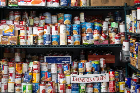 Canned goods are stored on shelves, Friday, May, 3, 2019, at Grace Place Food Pantry in Golden Gate.