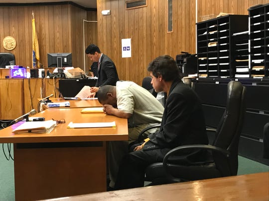 Harold Johnson, (center), with his attorney, Gregory Aprile, as the verdict is read.