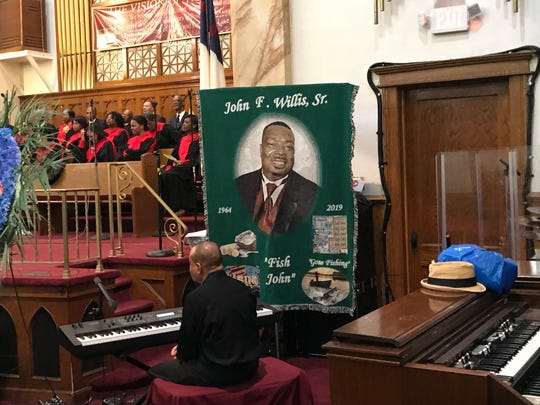 Scores were on hand Thursday to celebrate the life of John Willis.