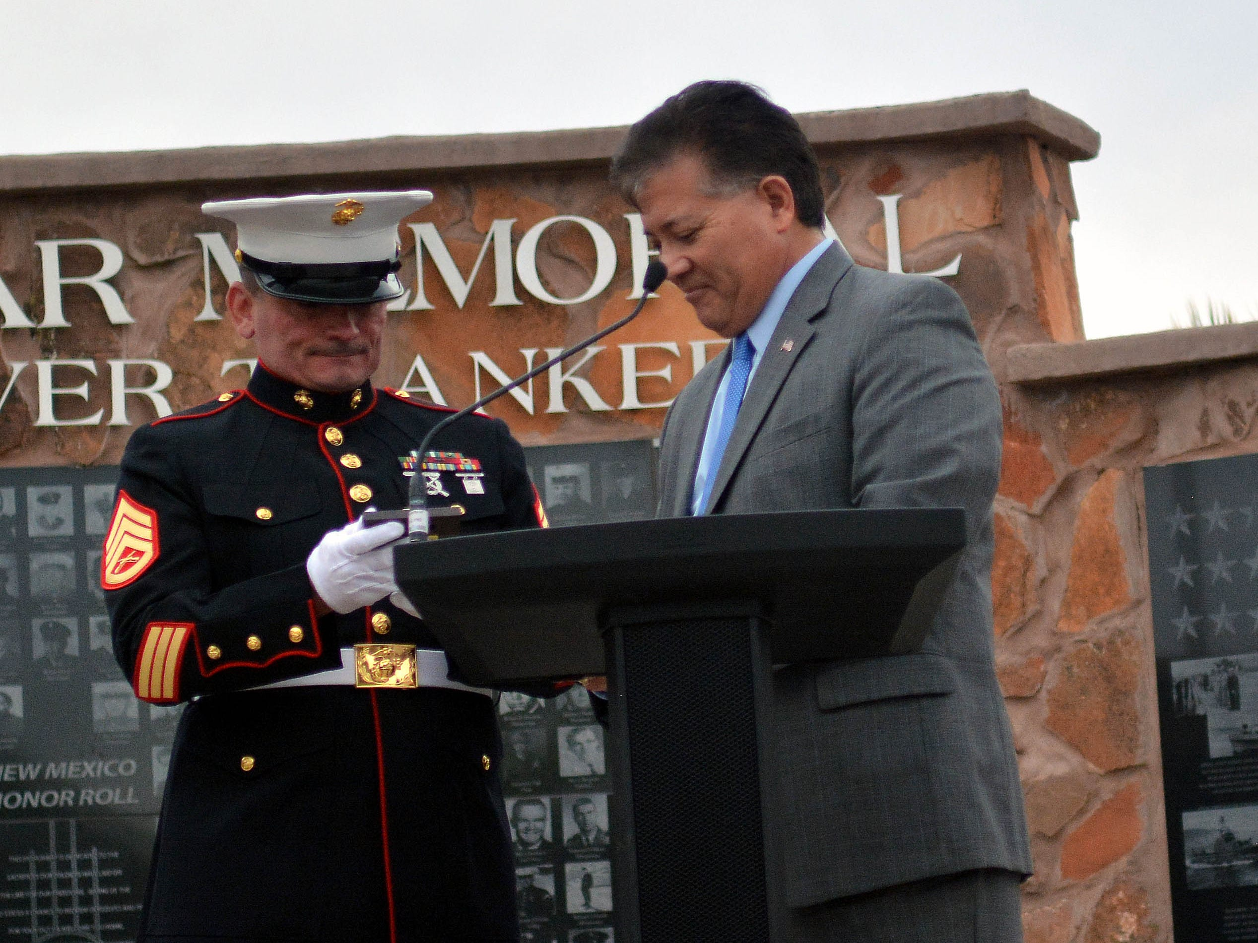 Las Cruces Mayor Ken Miyagishima presents USMC veteran Tim Chambers with a Key to the City on Thursday, May 2, 2019.