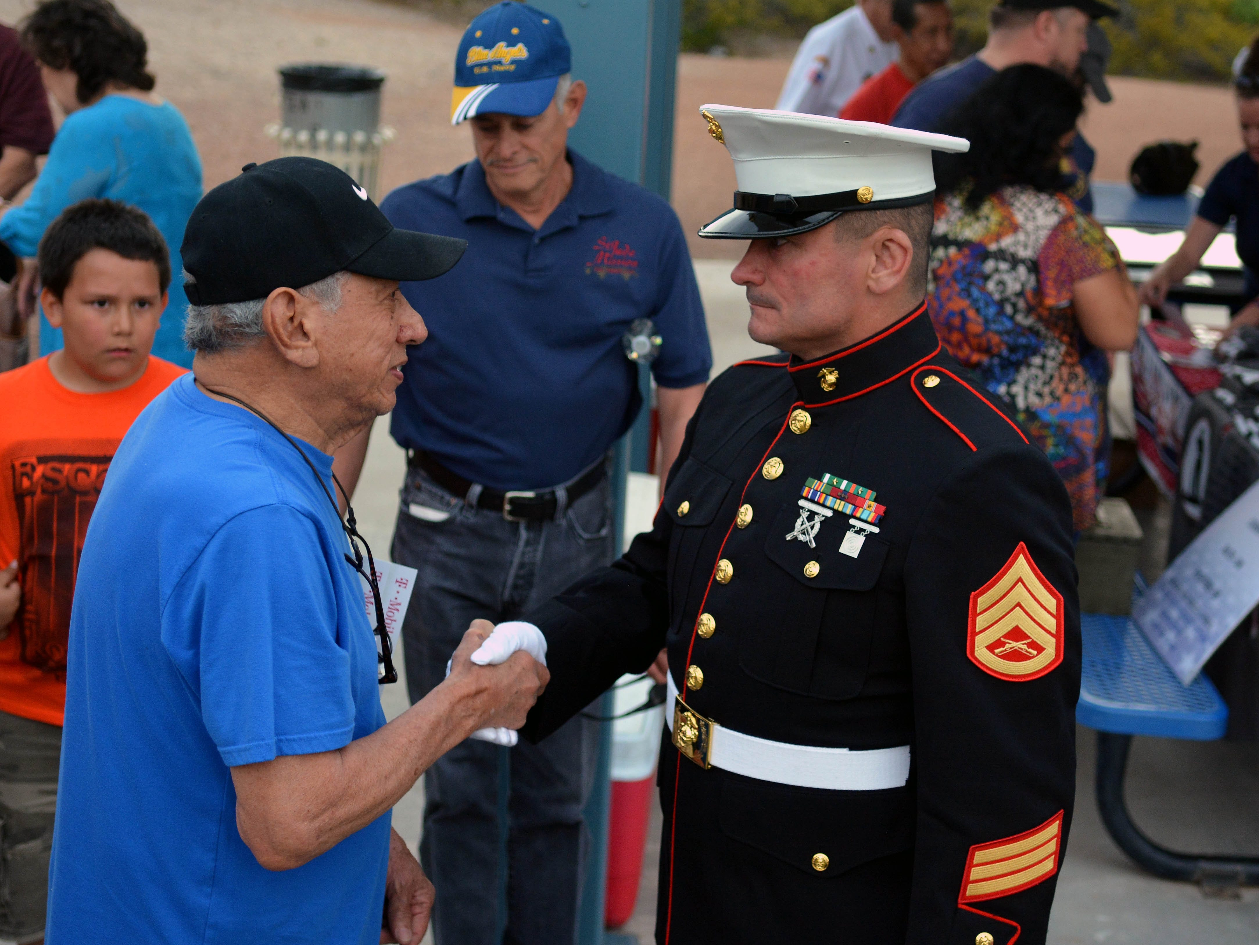 US Air Force veteran Roman Bernal, left, takes time to meet Tim Chambers, known as The Saluting Marine, on Thursday, May 2, 2019, at Veterans Memorial Park in Las Cruces.