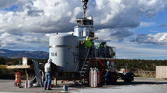 A crew prepares a waste shipment at Los Alamos National Laboratory for transport to the Waste Isolation Pilot Plant.