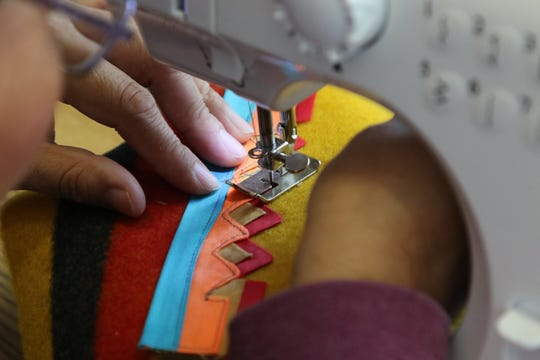 Participants learned how to operate sewing machines during the Navajo Cultural Arts Program session on Friday at Diné College's south campus in Shiprock.