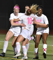 Salem Rocks celebrate teammate Sydney Smith's (#10) goal in the second half of their May 2 game against Plymouth.