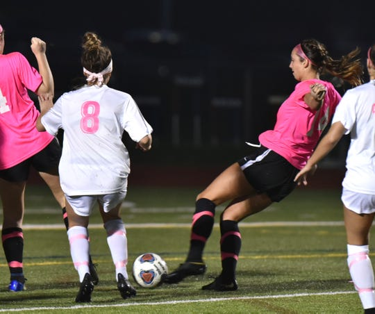 Plymouth's Kennedy White, second from right, sent this shot past Salem goalie Gwen Pratt for the Wildcat's first goal of their eventual 3-1 victory on May 2.