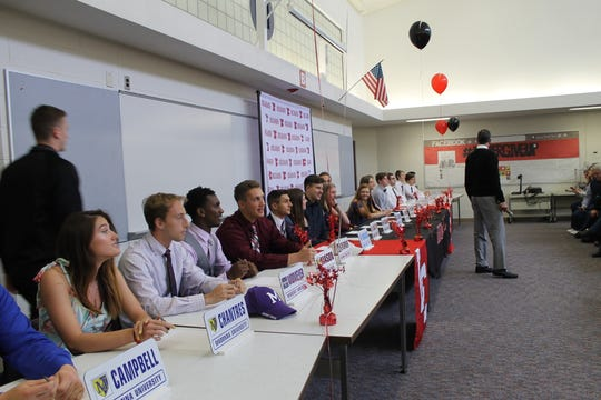 Livonia Churchill held a signing ceremony for its 21 college bound athletes.