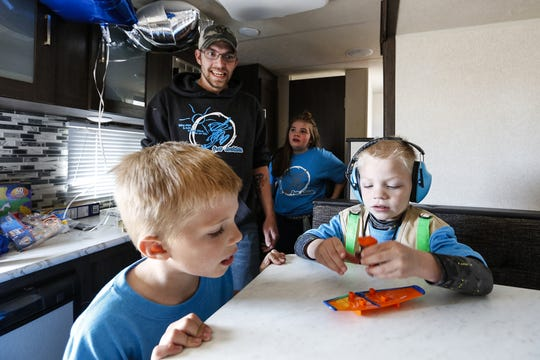 Brother Skyler, father Keith and sister Savana Schroeder watch Slayden Schroeder play with a toy Friday, May 3, 2019 at Bergstrom Chevrolet Buick GMC of Oshkosh in their new camper gifted from Bergstrom and the Make A Wish Foundation. Slayden is affected by intractable epilepsy and because of his love for camping wanted a camper. Doug Raflik/USA TODAY NETWORK-Wisconsin