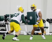 Packers offensive lineman Elgton Jenkins (right) blocks during rookie minicamp at the Don Hutson Center on May 3, 2019