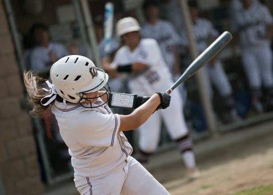 La Quinta senior Beatriz Ojeda hits a ball during the CIF Division 3 softball playoffs at La Quinta High School on Thur. May. 2, 2019.