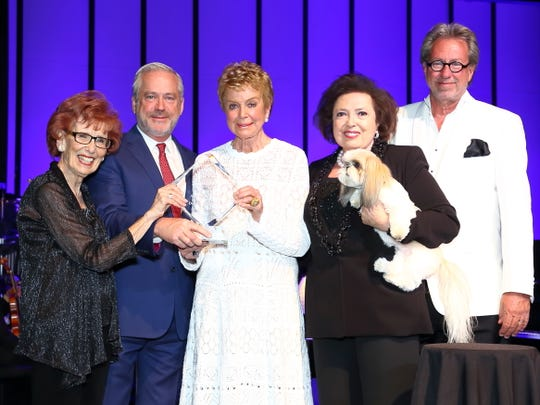From left: Marilyn Benachowski, Bill Nicholson, Donna MacMillan, Nancy Tapick with Symphony Sammy, and Dan McGrath
