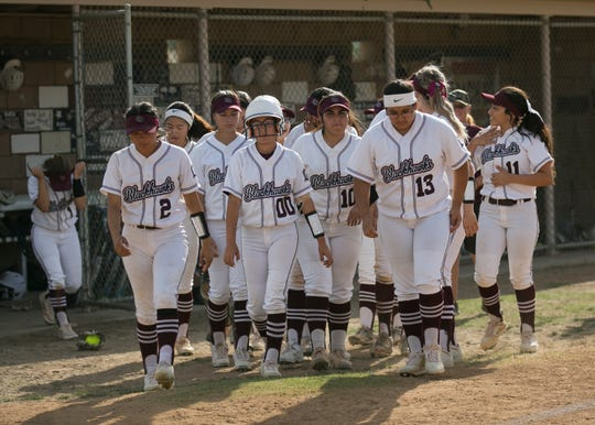The La Quinta varsity softball team leaves the dugout after losing the opening match in the CIF Division 3 softball playoffs to Diamond Ranch high school at La Quinta High School on Thur. May. 2, 2019.