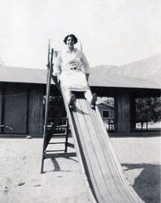 Katherine Finchy on the top of the slide at the first Palm Springs school.