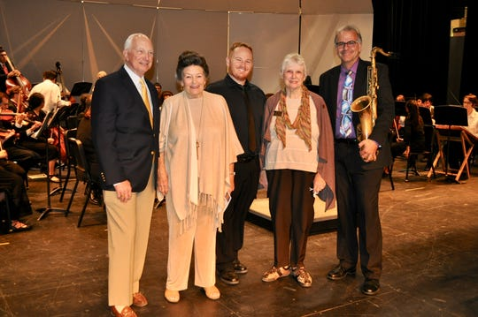 From left: Christopher Seidel; Marjorie Conley Aikens, co-chair of Palm Springs Concerts' Student Outreach Program; Jason Powell; Barbara Hawkins Villani, co-chair; and Rob Verdi. In the background are members of the Palm Springs High School Orchestra.