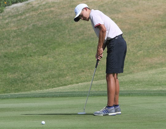 Braden Bernaldo of Palm Desert putts during the Desert Empire League boys golf individual finals at the Gary Player Signature Course, Westin Mission Hills Resort in Rancho Mirage, May 2, 2019.