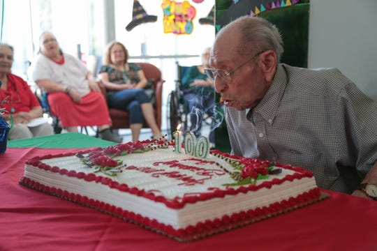 Fred Ayala blows out candles for his 100th birthday, Palm Springs, Calif., May 3, 2019.