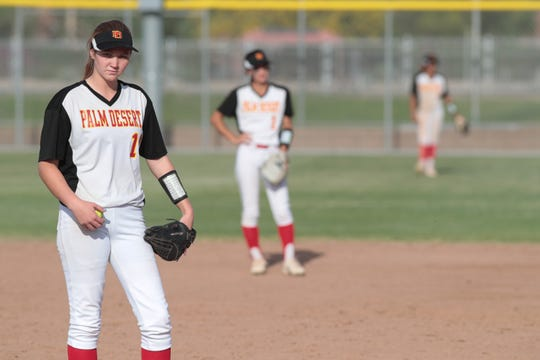 Carlie Williams looks to her coach before pitching against  Etiwanda in a CIF playoff game, Palm Desert, Calif., May 2, 2019.