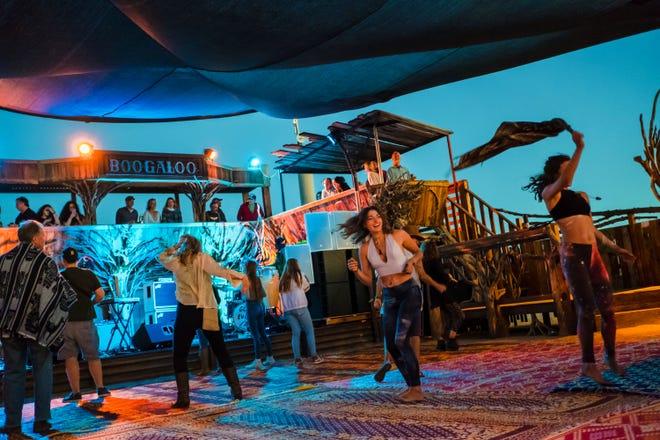 Festivalgoers dance at the Joshua Tree Music Festival in fall 2018.