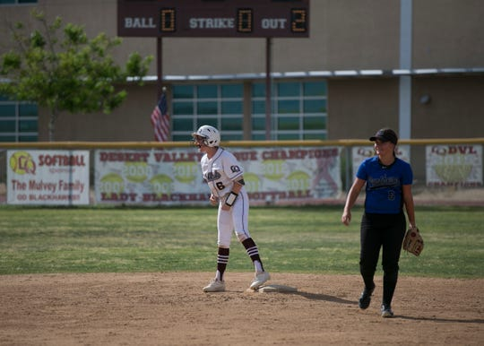 La Quinta sophomore Abby Mulvey (center) yells to her teammates from second base during the CIF Division 3 softball playoffs at La Quinta High School on Thur. May. 2, 2019.