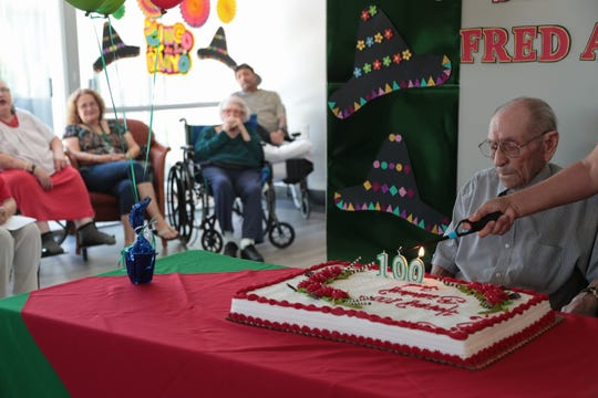 Fred Ayala celebrates his 100th birthday with friends and family in Palm Springs, Calif., May 3, 2019.