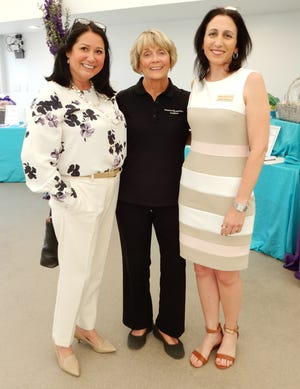 From left to right: Education, Outreach, and Operations Manager Kimberly Spiegel; Jane Connolly, a caregiver whose husband participates in the Alzheimer's Association SongShine Music Therapy Program; and Program and Education Manager Jennifer Zuckerman