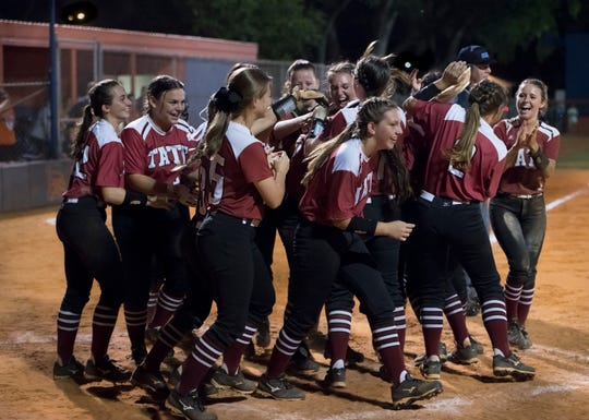 Teammates greet Amber Decoux (17) as she crosses home on a solo homer and the Aggies take a 14-2 lead in the top of the 7th inning during the Tate vs Escambia district 1-7A softball championship game at Escambia High School in Pensacola on Thursday, May 2, 2019.  The Aggies won 14-2.